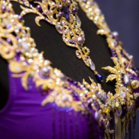 Purple beaded latin with golden lace